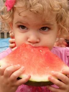 Girl Eating Melon